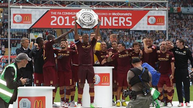 Manchester City captain Vincent Kompany lifts the FA Community Shield