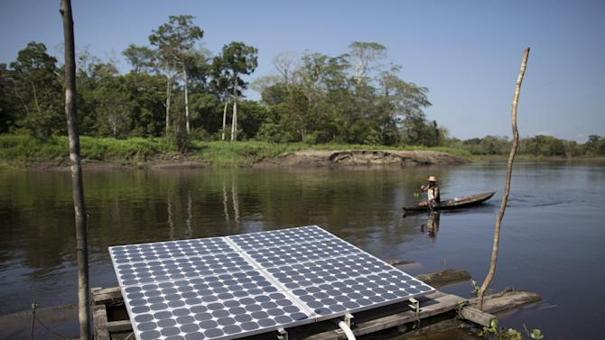 Solar panels power water pumps to supply river water to the houses of the Vila Nova do Amana community in the Sustainable Development Reserve, in Amazonas state