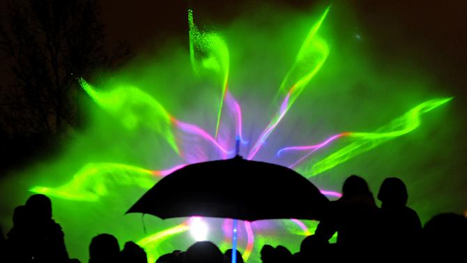 AP10ThingsToSee - People watch a fountain light show in Warsaw, Poland, Friday, May 3, 2013. (AP Photo/Alik Keplicz, File)