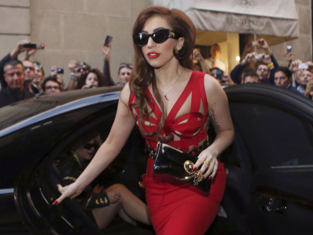 "FILE - In this Monday, Oct. 1, 2012 file photo, Lady Gaga arrives at the Versace atelier in Milan, Italy. Lady Gaga is donating $1 million to the Red Cross to aid those affected by Superstorm Sandy. The New York-born singer posted on her blog Wednesday, Nov. 7, 2012 that she is pledging the money on behalf of her parents and sister. She also said she ""would not be the woman or artist that I am today"" if it weren't for places like the Lower Eastside, Harlem, the Bronx and Brooklyn. She writes: ""Thank you for helping me build my spirit. I will now help you rebuild yours."" (AP Photo/Luca Bruno)"