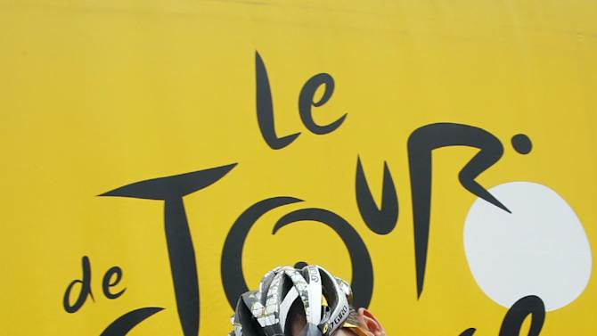 FILE - In this July 9, 2010, file photo, Lance Armstrong prepares to take the start of the sixth stage of the Tour de France cycling race over 227.5 kilometers (141.4 miles) with a start in Montargis and finish in Gueugnon, France. Armstrong said on Thursday, Aug. 23, 2012, that he is finished fighting charges from the United States Anti-Doping Agency that he used performance-enhancing drugs during his unprecedented cycling career, a decision that could put his string of seven Tour de France titles in jeopardy. (AP Photo/Christophe Ena, File)