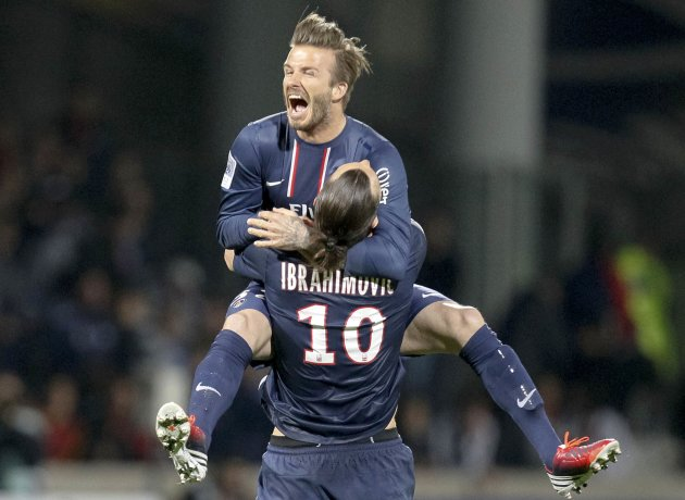 Paris Saint-Germain's Ibrahimovic and Beckham celebrate at the end of their team's French Ligue 1 soccer match against Olympique Lyon at the Gerland stadium in Lyon