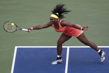 Williams of the U.S. hits a return to Bertens of the Netherlands during their second round match at the U.S. Open Championships tennis tournament in New York,