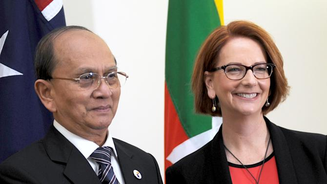 President of Myanmar Thein Sein, left, shakes hands with Australian Prime Minister Julia Gillard as they meet at Parliament House in Canberra, Australia, Monday, March 18, 2013. Thein is on a three day visit to Australia.  (AP Photo/Alan Porritt, Pool)