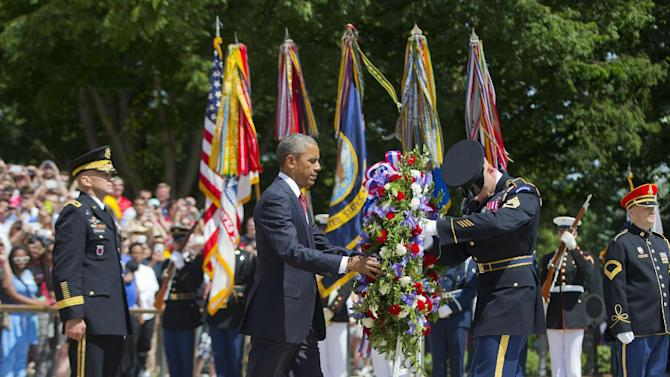President Barack Obama, accompanied by Maj. Gen. Jeffrey S. Buchanan, left, Commander of the U.S. Army Military District of Washington, and the with the aid of  Sgt. 1st Class John C. Wirth, lays a wreath at the Tomb of the Unknowns, on Memorial Day, Monday, May 25, 2015, at Arlington National Cemetery in Arlington, Va.  (AP Photo/Pablo Martinez Monsivais)