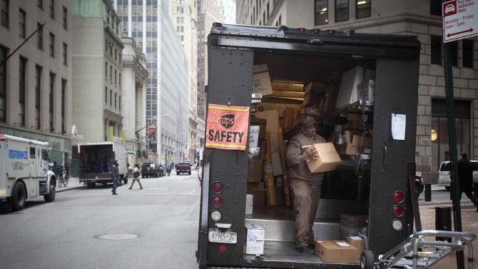 A UPS worker sorts packages to be delivered on Broad Street in Manhattan