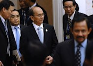 Myanmar's President Thein Sein (C) and Laos Prime Minister Thongsin Thamavong (2nd L) arrive at the Association of Southeast Asian Nations (ASEAN) meeting in Phnom Penh on April 4, 2012. Southeast Asian leaders at the summit are expected Wednesday to issue a formal call for the West to ease sanctions on Myanmar