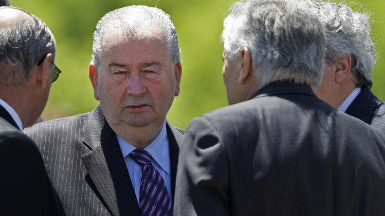 FILE - In this Oct. 31, 2008 file photo, Julio Grondona, president of Argentina's Football Association, (AFA), attends the funeral of Pedro Pompilio, the president of Argentina's Boca Juniors soccer team, on the outskirts of Buenos Aires. Grondona, who died Wednesday, July 30, 2014, from a heart problem, served as president of the AFA since 1979, and vice president of FIFA since 1988. He was 82. (AP Photo/Natacha Pisarenko, File)