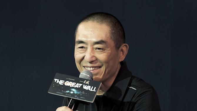 "In this July 2, 2015 photo, movie director Zhang Yimou speaks at a press conference of his latest movie ""The Great Wall"" at a hotel in Beijing. Zhang has sued a production company that he has worked with for more than a decade, seeking 15 million yuan ($2.5 million) he says he is owed as his share of the distribution money of one of his movies. His lawyers argued Tuesday, July 7, 2017 at Beijing Chaoyang District Court that Zhang hadn't received his share of money for his 2009 film ""A Woman, a Gun and a Noodle Shop,"" a dark comedy about a noodle shop owner scheming to murder his wife and her lover. (AP Photo/Andy Wong)"