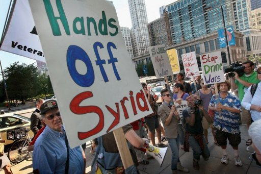 Demonstrators protest against military intervention in Syria outside President Barack Obama&#39;s national campaign headquarters on June 26, in Chicago, Illinois. Syrian President Bashar al-Assad said his country was in a state of war and ordered his new cabinet to crush the anti-regime uprising as Turkey vowed to retaliate for the downing of one of its jets