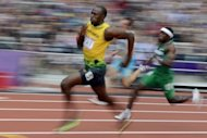 Jamaica's Usain Bolt (L) and Nigeria's Noah Akwu (R) during in the men's 200m heats at the London Olympics on August 7. Bolt, fresh from running the second-fastest time in history to retain his 100m title on Sunday, began his bid to keep his 200m title by winning his heat in 20.39sec