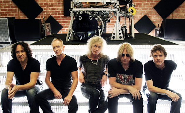 "This May 31, 2012 photo shows, from left, Vivian Campbell, Phil Collen, Rick Savage, Joe Elliott, and Rick Allen, of musical group Def Leppard in Los Angeles. The band re-recorded two of their songs that appear in the film, ""Rock of Ages""and they're teaming up with Poison and Lita Ford for a summer tour kicking off June 20 in Salt Lake City, Utah. (Photo by Matt Sayles/Invision/AP)"
