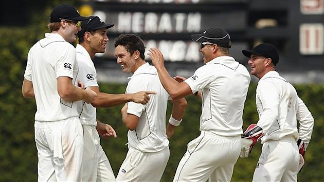New Zealand's captain Ross Taylor (2nd L) and Trent Boult (C) celebrate with Martin Guptill (L) ,Neil Wagner (2nd R) and Kruger van Wyk after taking the wicket of Sri Lanka's Suraj Randiv during the final day of second and final Test in Colombo (Reuters)