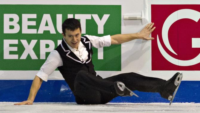 Patrick Chan, of Canada, falls as he performs his short program in the men's competition at the ISU Grand Prix of Figure Skating final on Friday, Dec. 9, 2011, in Quebec City. (AP Photo/The Canadian Press, Jacques Boissinot)