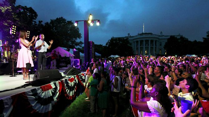 President Barack Obama and First lady Michelle Obama greet military families and guests for an Independence Day celebration in Washington