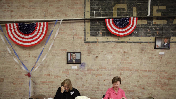 Volunteers Pam Budde, left, and Judy Amirjahed make phone calls to potential voters at the Bowling Green Romney Victory Headquarters Monday Nov. 5, 2012 in Bowling Green, Ohio. (AP Photo/J.D. Pooley)