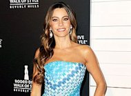 Sofia Vergara shows of her famous curves in a gorgeous blue Missoni column dress