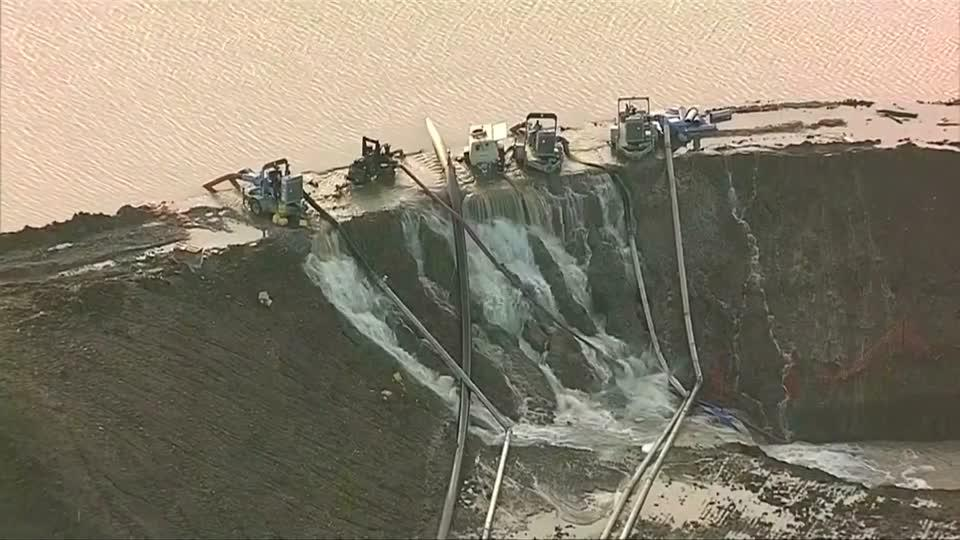 Texas lake breaches dam after days of flooding