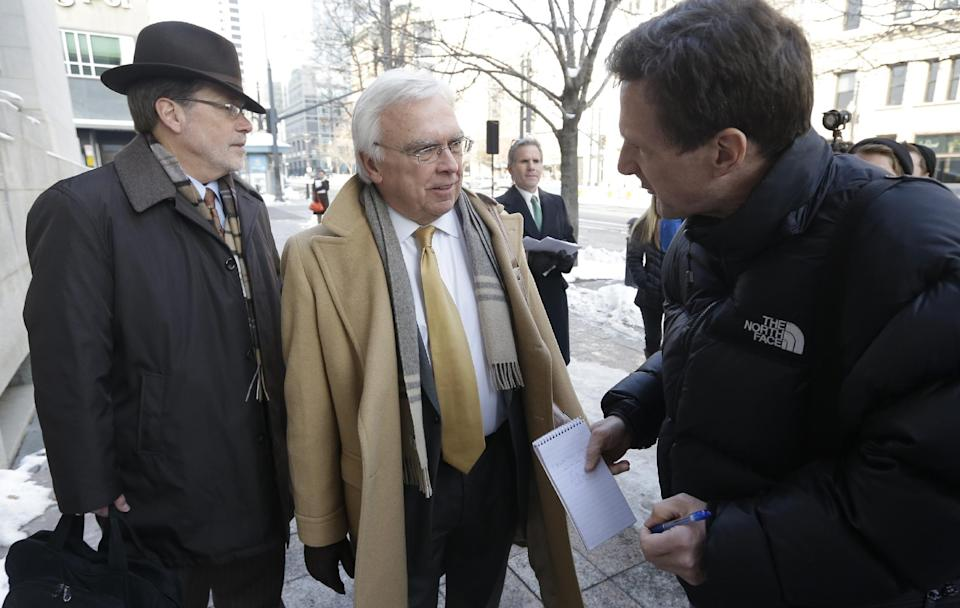 "Utah Assistant Attorney General Jerrold Jensen, center, speaks with a reporter before entering the Federal court in Salt Lake City, Thursday, Jan. 17, 2013, for a hearing in the ""Sister Wives"" lawsuit challenging Utah's bigamy laws. (AP Photo/Rick Bowmer)"