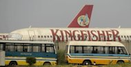A Kingfisher airline plane sits parked at the International airport in New Delhi. The flying licence of India&#39;s Kingfisher Airlines was suspended Saturday after the debt-laden carrier failed to satisfy the aviation regulator&#39;s concerns about its operations, an official said