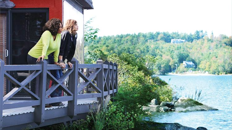 """In this Sept. 21, 2011 photo released by Harpo Inc., TV personality Oprah Winfrey and rocker Steven Tyler are shown at Tyler's lakefront home in Lake Sunapee, N.H. during the filming of an interview for """"Oprah's Next Chapter"""" premiering Sunday, Jan. 1, 2012 at 9 p.m. EST on OWN. Winfrey is tasked with rescuing OWN, the Oprah Winfrey Network, after a disappointing first year. (AP Photo/Harpo, George Burns)"""