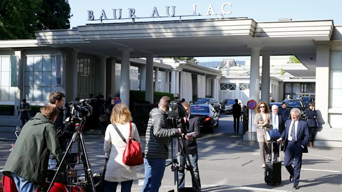 Members of the media stand outside the Baur au Lac hotel in Zurich