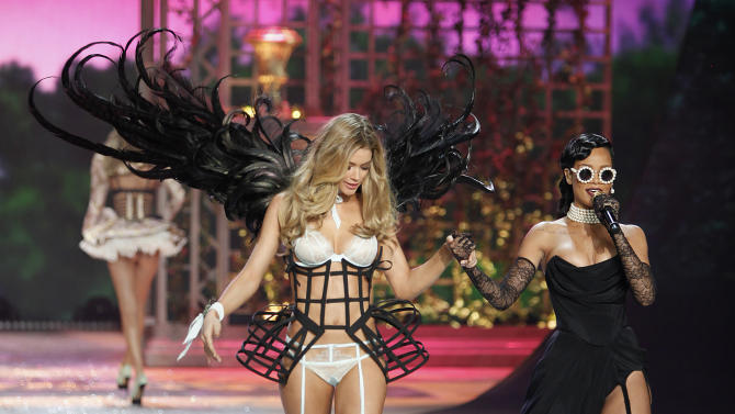 Singer Rihanna sings while a model presents a creation during the Victoria's Secret Fashion Show in New York