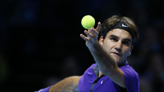 Roger Federer of Switzerland serves to David Ferrer of Spain during their ATP World Tennis Finals singles match in London Thursday, Nov. 8, 2012. (AP Photo/Kirsty Wigglesworth)