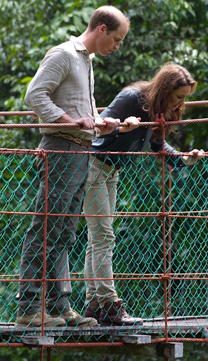 Britain's Prince William, left, and Kate, the Duchess of Cambridge look down on the three-hundred meter in length Canopy Walkway during their visit at the Borneo Rainforest Lodge in Danum Valley, some