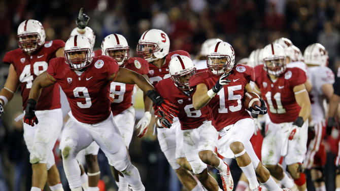 Stanford cornerback Usua Amanam (15) celebrates after an interception against Wisconsin late in the second half of the Rose Bowl NCAA college football game, Tuesday, Jan. 1, 2013, in Pasadena, Calif. Stanford won 20-14. It was Stanford's first Rose Bowl victory in 40 years. (AP Photo/Jae C. Hong)