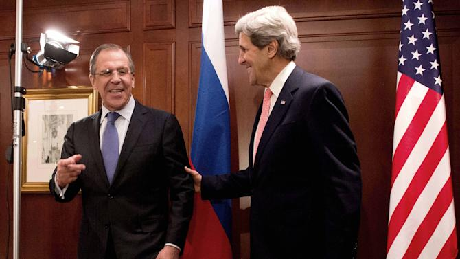 U.S. Secretary of State John Kerry, right,  meets with  Russian Foreign Minister Sergey Lavrov  in Berlin on Tuesday, Feb. 26, 2013. Berlin is the second stop in Kerry's first trip overseas as Secretary of State.  (AP Photo/dpa,Maurizio Gambarini)