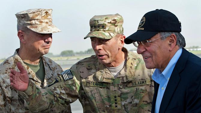 FILE - In this July 9, 2011 file pool photo, USMC Gen. John Allen, left, and Army Gen. David Petraeus, top U.S. commander in Afghanistan and incoming CIA Director, greet former CIA Director and new U.S. Defense Secretary Leon Panetta, right, as he lands in Kabul, Afghanistan, Saturday, July  9, 2011.  (AP Photo/Paul J. Richards, Pool)