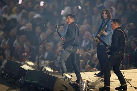 Members of the band Arctic Monkeys perform during the opening ceremony of the London 2012 Olympic Games at the Olympic Stadium July, 27, 2012. REUTERS/Mike Blake/Files