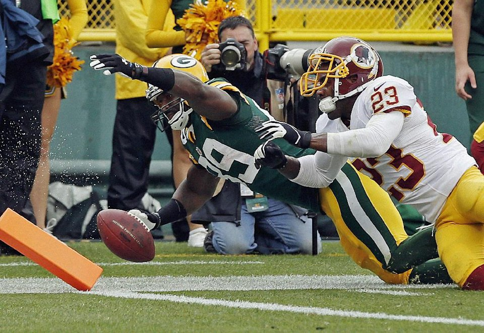 Washington Redskins' DeAngelo Hall (23) knocks Green Bay Packers' James Jones (89) out of bounds after a catch during the first half of an NFL football game Sunday, Sept. 15, 2013, in Green Bay, Wis