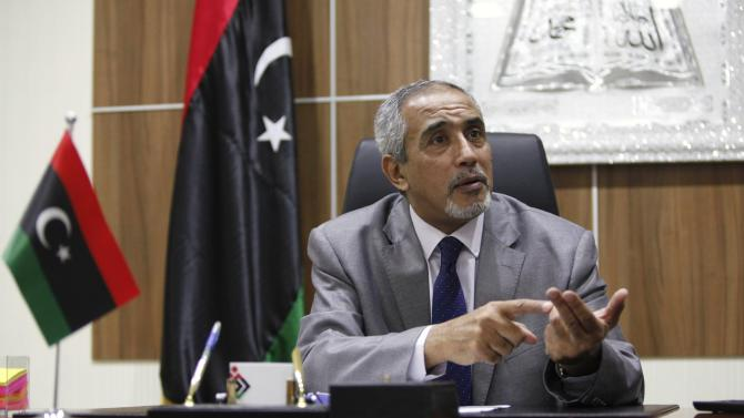 Hassi speaks during an interview in Tripoli