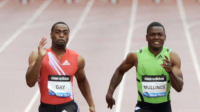 Jamaica's Steve Mullings, right, competes and wins the 100-meter race over Tyson Gay, of the U.S., despite both finishing with an identical time of 10.26 seconds at the Adidas Grand Prix track and field meet on Randall's Island in New York, Saturday, June 11, 2011. (AP Photo/Henny Ray Abrams)
