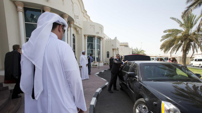U.S. Secretary of State John Kerry, not pictured, is secured in his vehicle on arrival in Doha, Qatar, on Saturday, June 22, 2013. Kerry is expected to attend a meeting of the London 11. The Secretary has begun the overseas trip with two thorny foreign policy problems facing the Obama administration: unrelenting bloodshed in Syria and efforts to talk to the Taliban and find a political resolution to the war in Afghanistan. (AP Photo/Jacquelyn Martin, Pool)