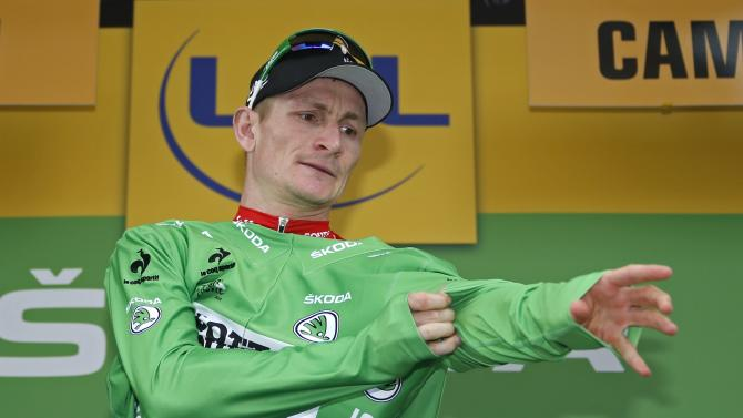 Lotto-Soudal rider Andre Greipel of Germany celebrates as he wears the green best sprinter jersey on the podium after the 223.5-km (138.9 miles) 4th stage of the 102nd Tour de France cycling race from Seraing in Belgium, to Cambrai, France