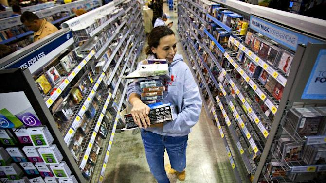 FILE -In this Friday, Nov. 23, 2012, file photo, Tonya Thomas, of Russellville, Ky., makes her way through the aisles at Best Buy in Bowling Green, Ky. U.S. consumer confidence rose this month to its highest level in almost five years, helped by a better outlook for hiring over the next six months. The Conference Board said Tuesday, Nov. 27, 2012, that its consumer confidence index rose to 73.7 in November from 73.1 in October. Both are the best readings since February 2008.  (AP Photo/Daily News, Alex Slitz)