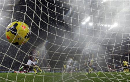 AC Milan's Kaka shoots to score against Lazio during their Italian Serie A soccer match in Milan