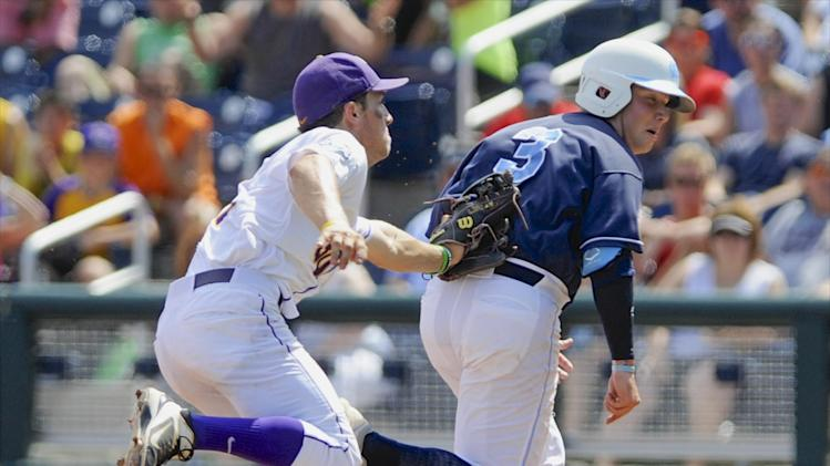 North Carolina's Mike Zolk, right, is tagged out in a run down by LSU shortstop Alex Bregman after Zolk attempted to steal second base in the sixth inning of an NCAA College World Series elimination game in Omaha, Neb., Tuesday, June 18, 2013. (AP Photo/Eric Francis)