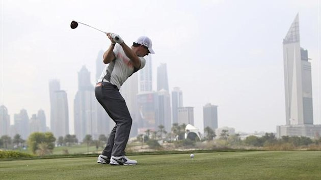 Rory McIlroy of Northern Ireland tees off on the eighth hole during the second round of the 2014 Omega Dubai Desert Classic in Dubai January 31, 2014 (Reuters)
