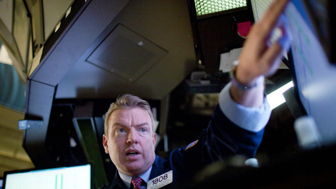 Trader Michael J. Omara works on the floor of the New York Stock Exchange on Wednesday, August 3, 2011, in New York. (AP Photo/Jin Lee)