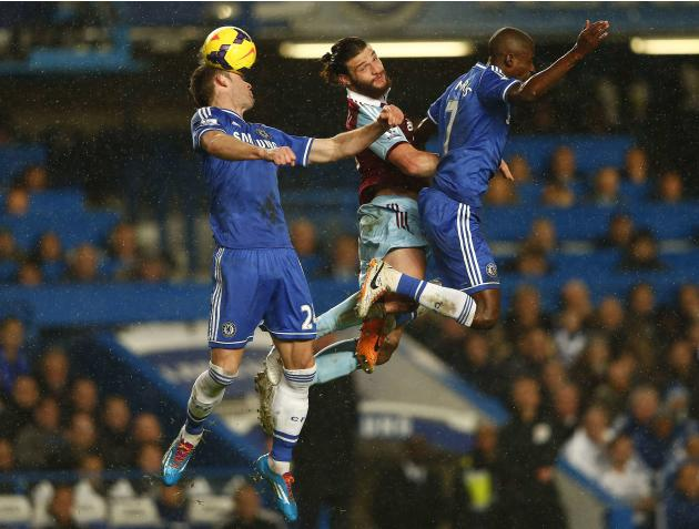 Chelsea's Cahill and Ramires challenge West Ham United's Carroll during their English Premier League soccer match at Stamford Bridge in London