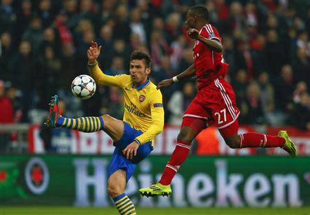 Bayern Munich's Alaba challenges Arsenal's Giroud during their Champions League round of 16 second leg soccer match in Munich