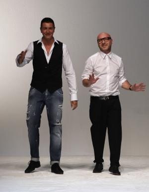 Italian fashion designers Stefano Gabbana, left, and Domenico Dolce acknowledge the applause at the end of the Dolce & Gabbana men's Spring-Summer 2012 collection show, part of the Milan Fashion Week, Milan, Italy, Saturday, June 18, 2011. (AP Photo/Luca Bruno)