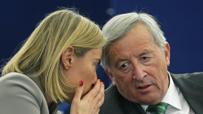European Commission President Juncker talks with European Union Foreign Policy Chief Mogherini during a debate at the European Parliament in Strasbourg