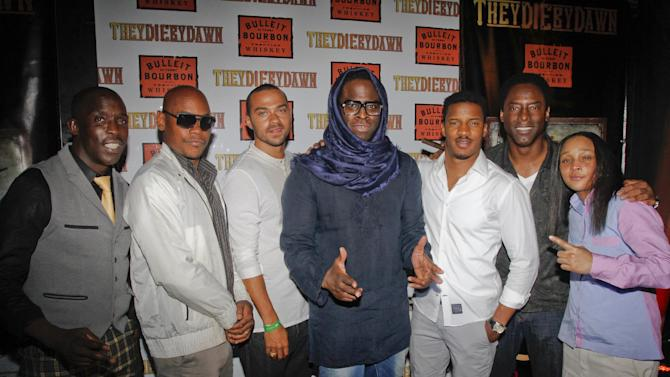 "IMAGE DISTRIBUTED FOR BULLEIT BOURBON - Director Jeymes Samuel, center, is joined by cast members Michael K. Williams, Bokeem Woodbine, Jesse WIlliams, Nate Parker, Isaiah Washington and Felicia Pearson, left to righ, on the red carpet at the Bulleit Bourbon presents ""They Die by Dawn"" premiere at SXSW, on Saturday, March 16, 2013 in Austin, Texas. (Photo by Jack Plunkett/Invision for Bulleit Bourbon/AP Images)"