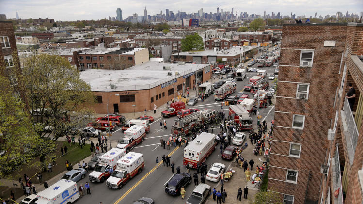 New York City emergency crews converge at 60th Street and Broadway to evacuate passengers from a subway train after it derailed in the Queens borough of New York, Friday, May 2, 2014. The express F train was bound for Manhattan and Brooklyn when it derailed at 10:40 a.m. about 1,200 feet (365 meters) south of the 65th Street station, according to the Metropolitan Transportation Authority. Dozens of firefighters and paramedics with stretchers converged on Broadway and 60th Street, where passengers calmly left the tunnel through the sidewalk opening. A few were treated on stretchers. (AP Photo/Julie Jacobson)