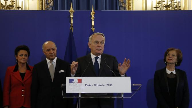 Newly-appointed French Foreign Minister Jean-Marc Ayrault delivers a speech next to outgoing Foreign Minister Laurent Fabius during the official handover ceremony at the Quai d'Orsay in Paris